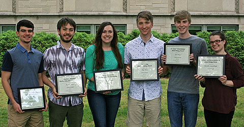 Six smiling students holding awards