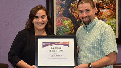 Hilary Morales holding Award