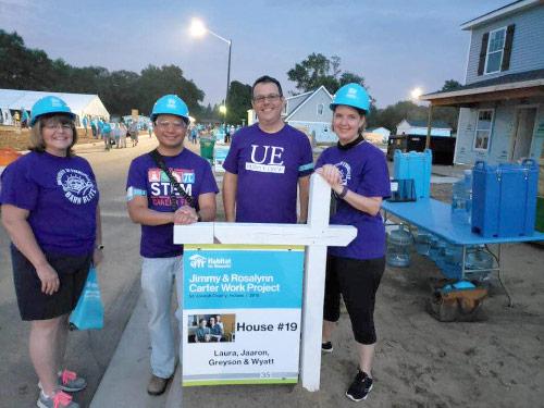 Beth Folz, Mark Valenzuela, Chuck Meacham, and Holly Carter by Habitat House sign