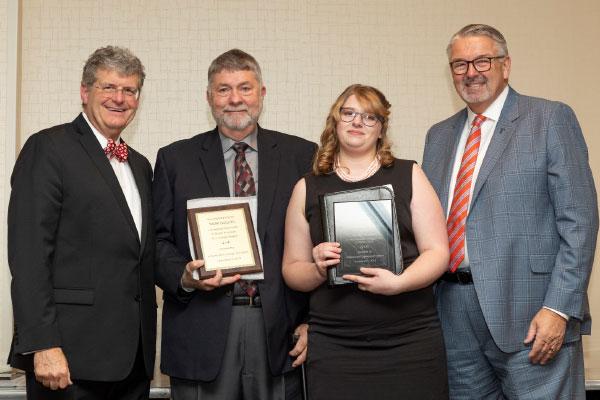 Lyndia Hayes holding award