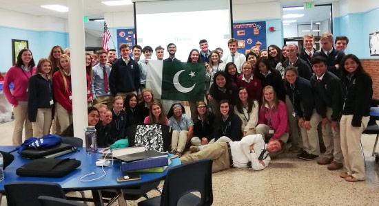 Muhammed Hassan Dajana with Reitz Memorial High School's International Club.