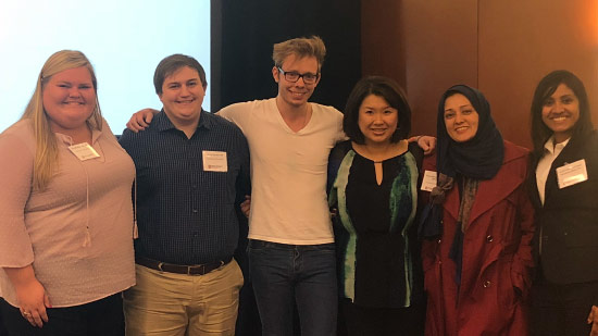 Group photo of Harness, Turner, Blyth-Clarke, Jeong, Shamim, and Abraham at conference.