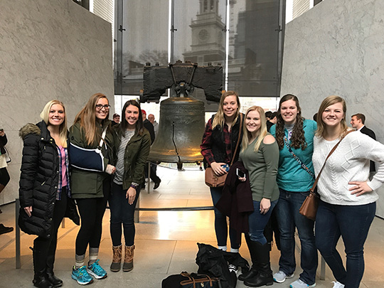 Students standing in front of the Liberty Bell