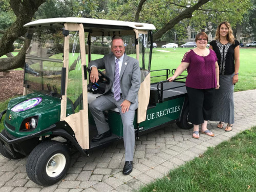 UE President sitting in the new Recycling Golf Cart