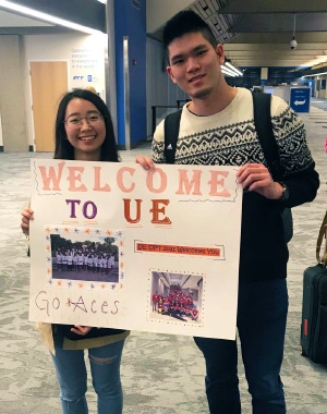 Taiwanese students holding up welcome sign