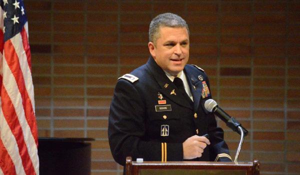 Michael Roscoe at podium speaking