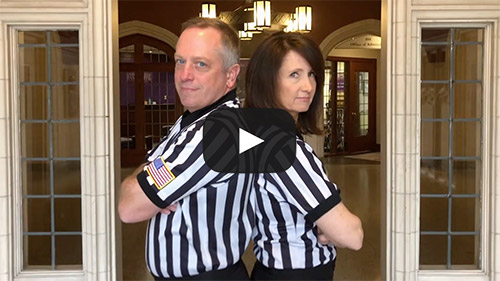 President and wife in referee uniforms.