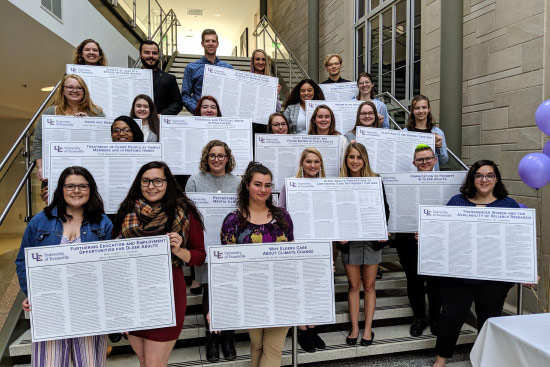 Sociology students holding posters
